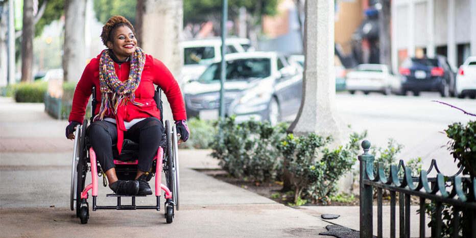 young, happy woman in wheelchair