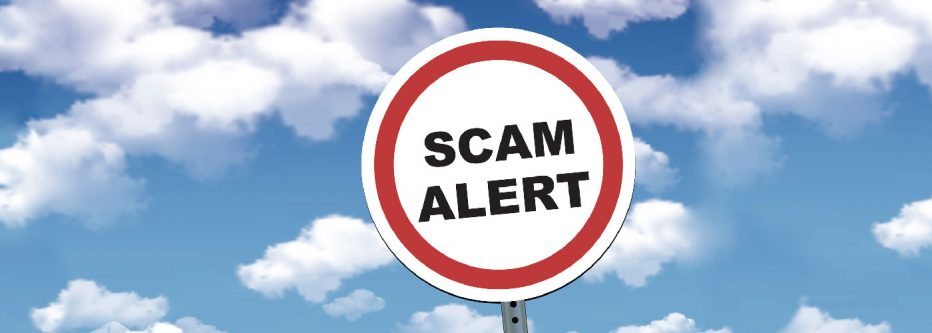 street sign reads Scam Alert