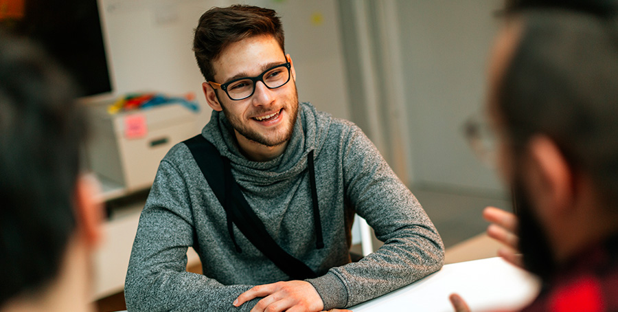 Image of a young man at a meeting